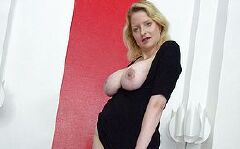 This big titted mature slut loves carrying on with herself